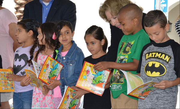 courtesy photo/supervisor josie gonzales facebook San Bernardino County Fifth District Supervisor Josie Gonzales reads with children during the Bloomington Branch Library grand opening.