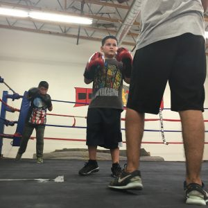 Photo/Anthony Victoria: Julian Serna, 8, training at the Cops4Kids gym in Colton.