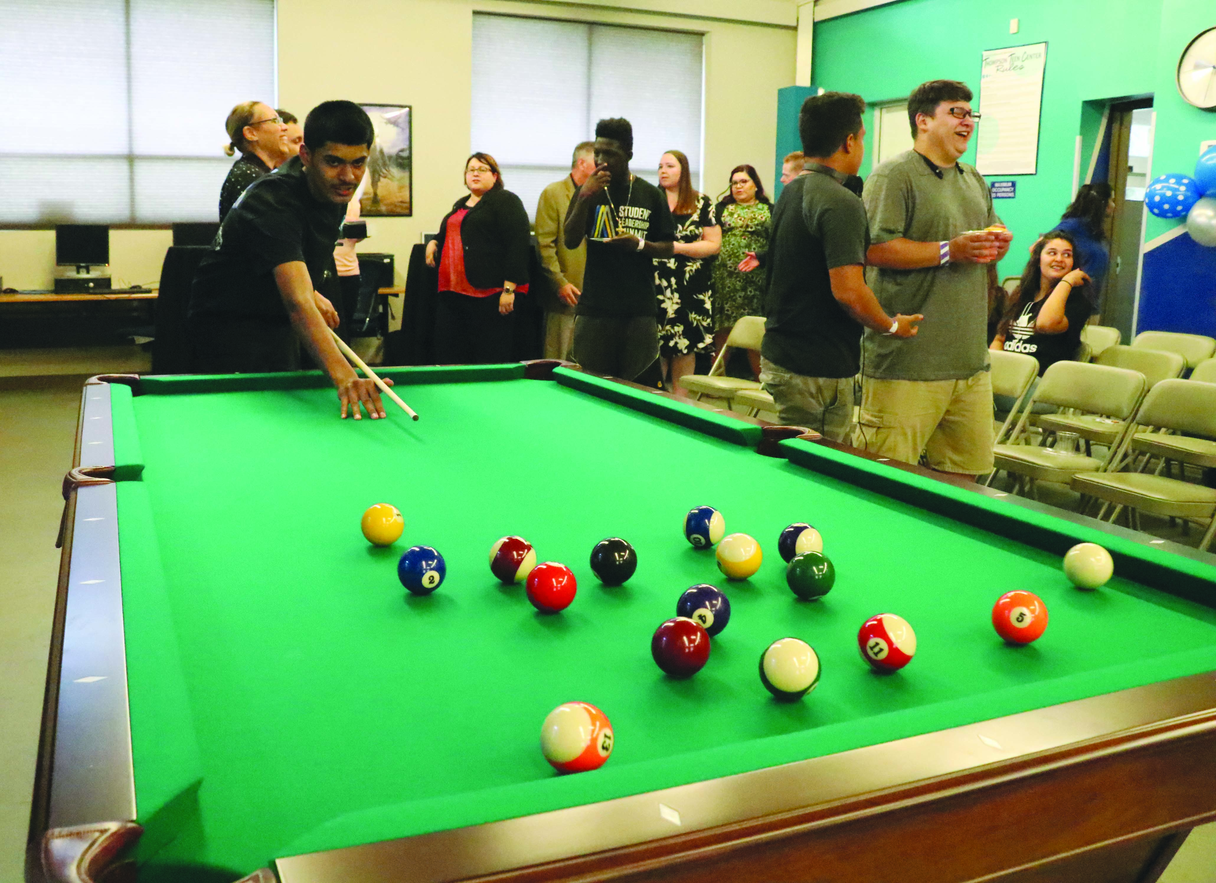 Photo/Anthony Victoria: Jonathan Cardenas Playing Billiards At The Art  Thompson Teen Center.