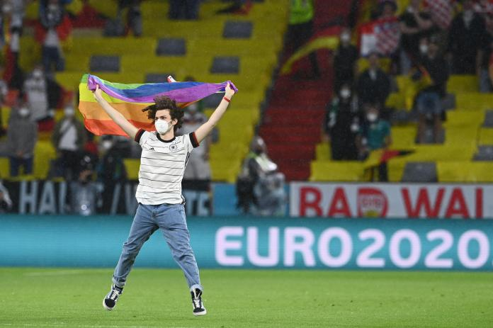 A man burst onto the pitch with a rainbow flag during the Germany-Hungary match on 23 June 2021 in Munich.