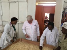 Ruth Kinoti, Shalem Investments founder and CEO, gives Scott Angle, IFDC president and CEO, a tour of a new factory that makes fortified sorghum flour from sorghum purchased from 2SCALE farmers.
