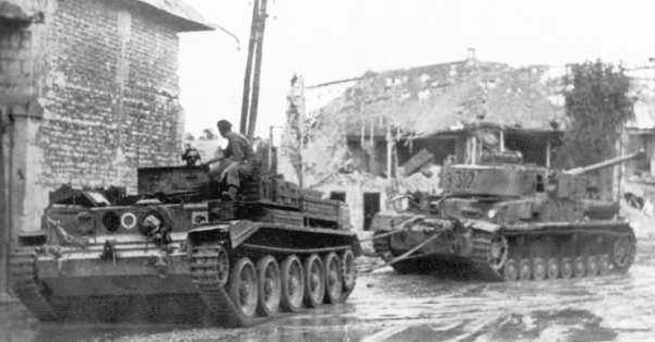 A Cromwell ARV towing a Panzer IV.