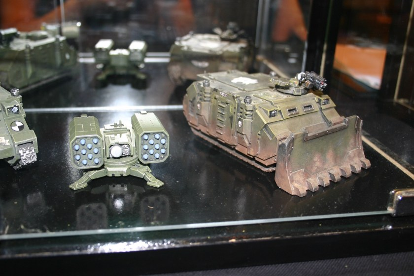 Space Marine Rhino with Forgeworld Dozer Blade, from the Forgeworld display cabinets.