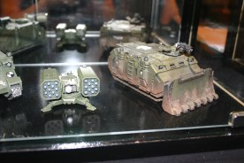 Space Marine Rhino with Forgeworld Dozer Blade and Hyperios Air Defence Platform on display in the Forgeworld cabinets at GamesDay