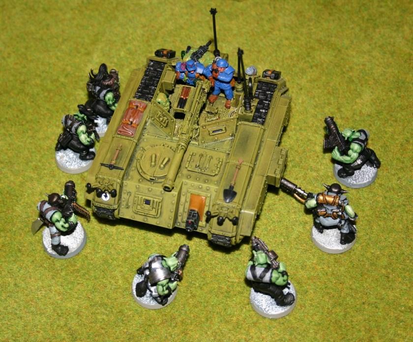 Imperial Salamander under attack by Orks