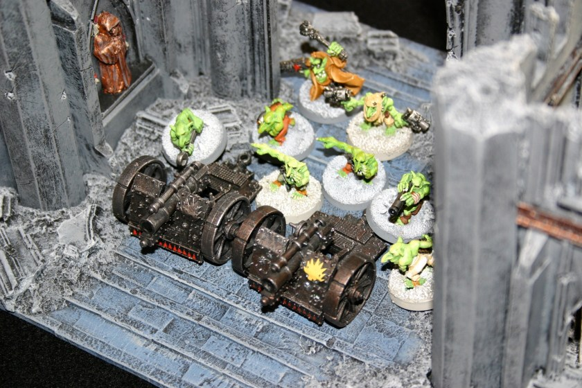 Grot Big Gunz in the ruins of an Imperial building.