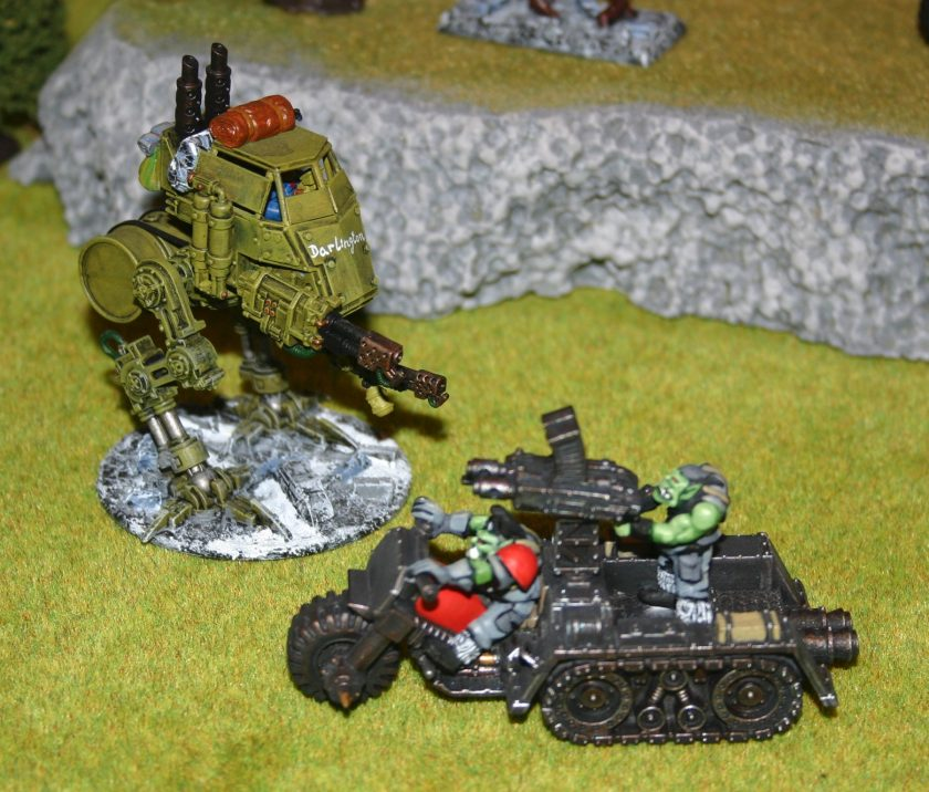 Wartrakk being attacked by Imperial Guard Sentinel