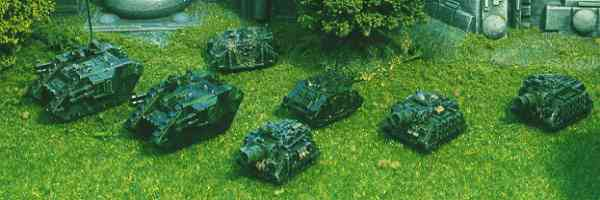 Vindicators, Rhinos and Land Raiders advance.