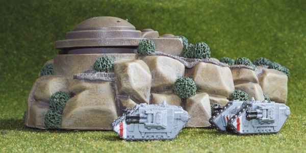 Land Raiders by a bunker.