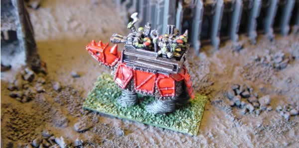 A Squiggoth with scratch-built howdah containing plastic ork infantry and some buggy gunners.