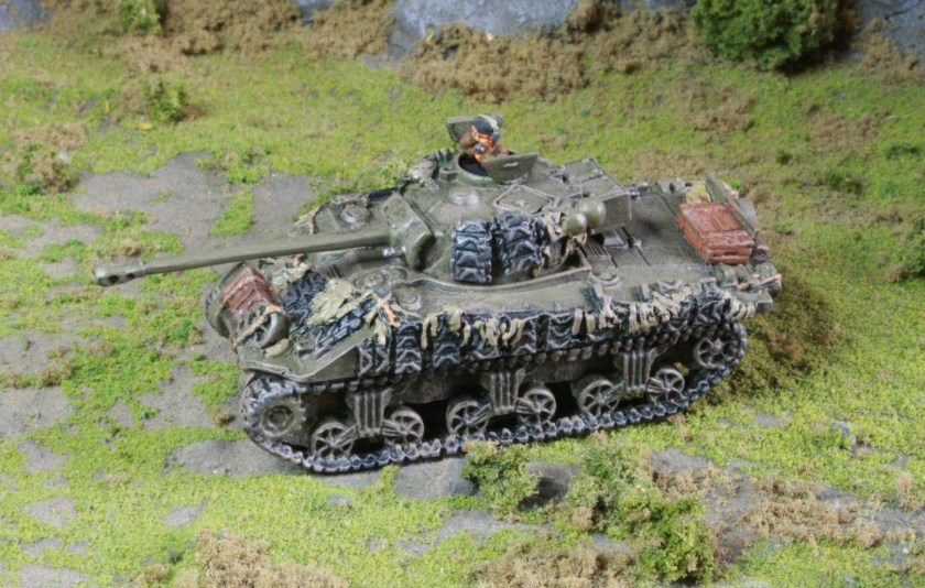 Sherman Firefly with extra tracks as added armour.