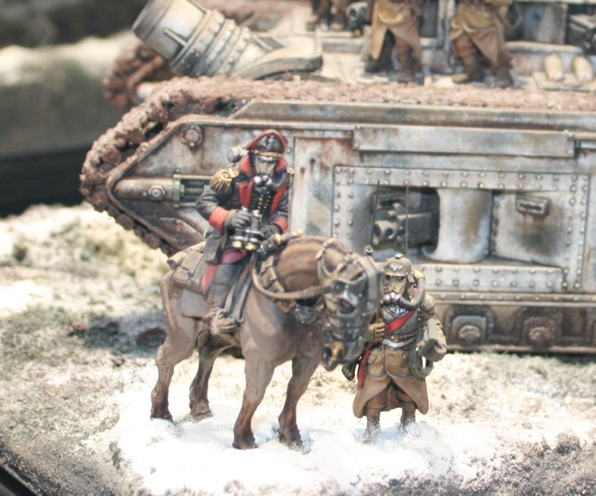 In front of the tank is a Death Korps of Krieg mounted officer.
