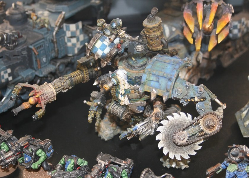 Ork Meka Dread - These modified Mega Dreads replace the big shootas with multiple tool-equipped servo-arms for battlefield 'fixins'.
