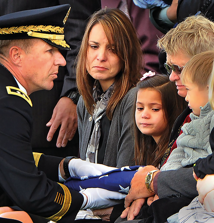 Police funeral – another fallen hero. There are many more untold victims of the professions of first responders – their families. Image courtesy of www.firstresponderwellness.com.