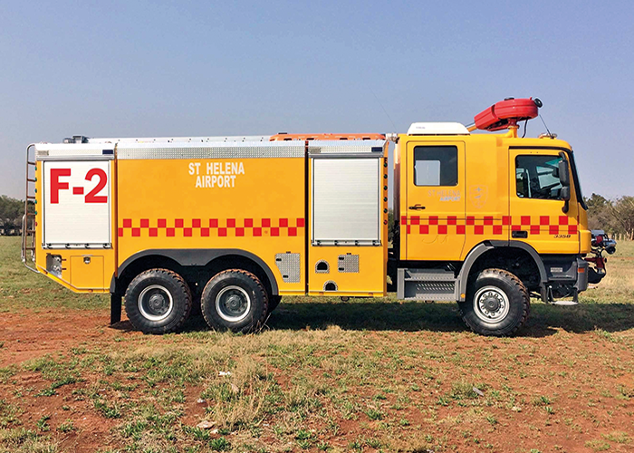 A side view of Fire 2 showing the clean lines of the Marcé crew cab extension, the St Helena Airport corporate livery and the battenburg markings.