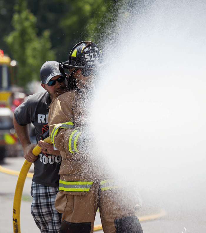 """""""HOT for Marriage"""" Hands on training where couples reinforce marriage skills with firefighting drills."""