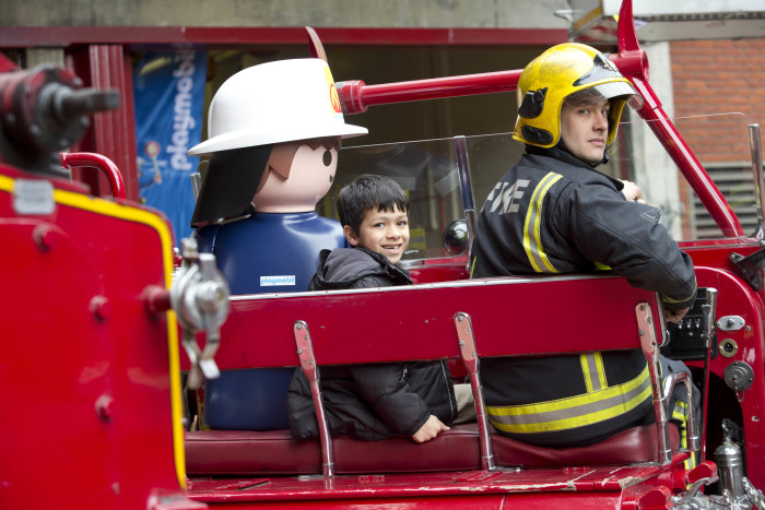 Playmobil partners with London Fire Brigade (LFB) to celebrate their 150th anniversary at Soho Fire Station yesterday (9th April, 2016) LFB and Playmobil firefighters teach young boy (Ziyad Marikar, aged 7) about the history of the fire engine, to mark the BrigadeÕs 150th year PIX:TIM ANDERSON