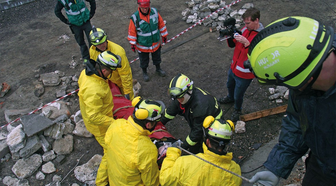 Rope rescuers in HUNOR were trained by expert from Hungarian Cave Rescue Organisation. Picture was taken at HUNOR INSARAG Reclassification Exercise at November 2012. UN Classifiers are watching the rope rescue operation.