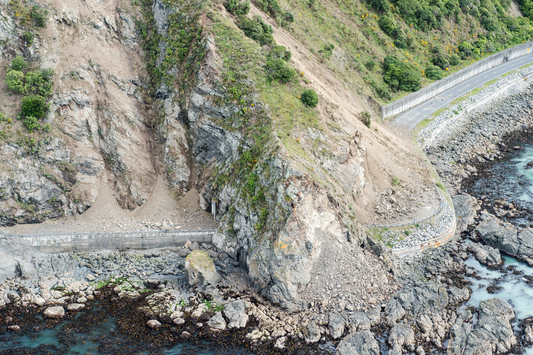 Landslides block State Highway One near Kaikoura on the upper east coast of New Zealand's South Island following an earthquake, November 14, 2016. Sgt Sam Shepherd/Courtesy of Royal New Zealand Defence Force/Handout via REUTERS