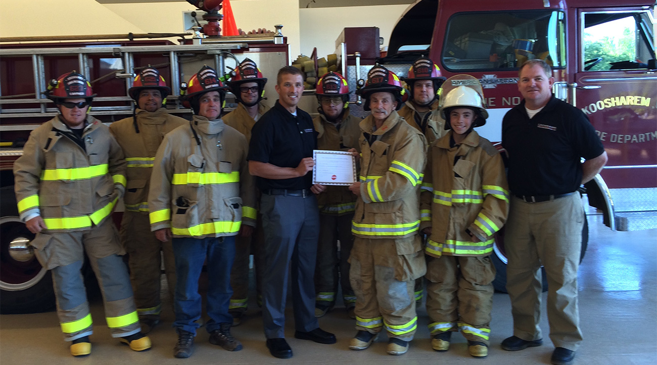 Tyler Dennison and Patrick Vietti from dealer partner, L.N. Curtis & sons, presenting the 2015 award to Koosharem Fire Rescue.
