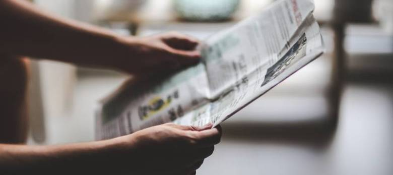 pick up a newspaper