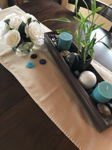 Home decor tip! This decorative centerpiece can be improved by adding a simple placemat to give emphasis and interest. #homedecor #DIY