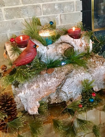 Decorate using birch logs and pine bough. Items found in nature make great decor. #decorating #nature