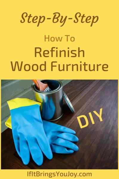Wood refinishing supplies on wood floor
