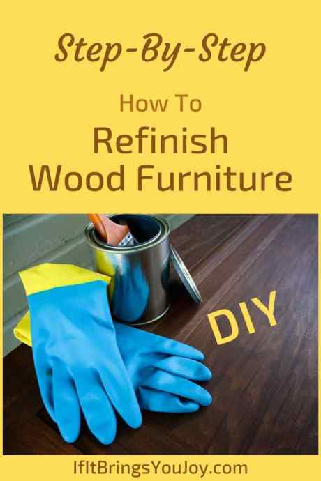 Wood refinishing supplies on wood floor