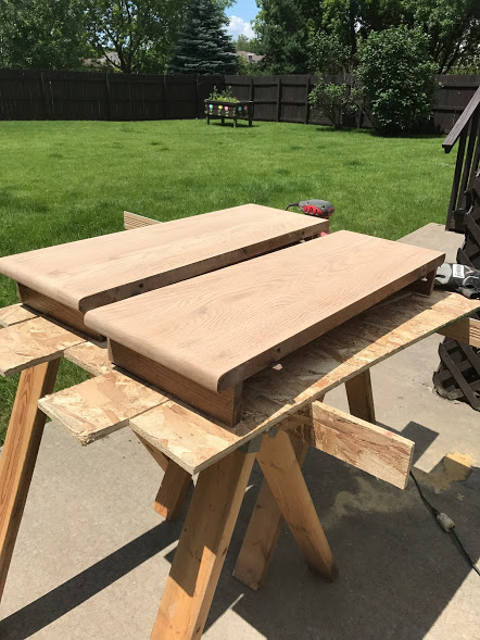 Wood kitchen table leaves that have been sanded and are ready for stain.