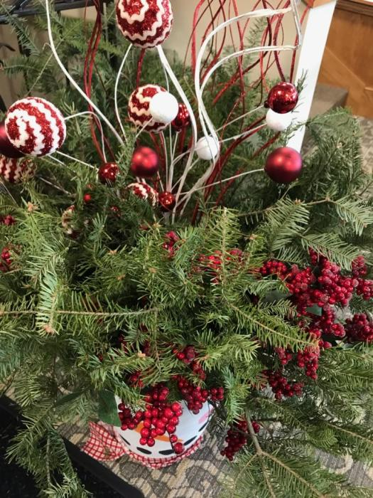 Table centerpiece made of fresh pine boughs. #decor #nature