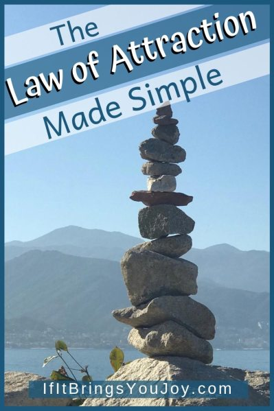 Large cairn with ocean and mountain background.