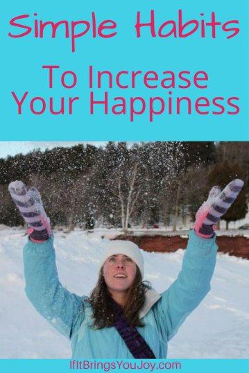 Happy lady enjoying throwing snowflakes