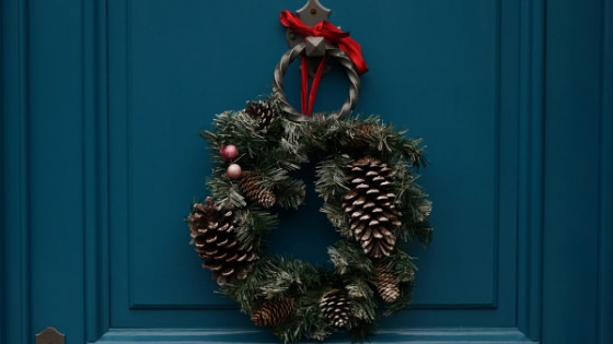 Wreath made with pine cones, pine bough, and other items found in nature.