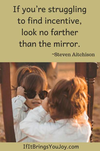Inspirational quote with girl looking in mirror