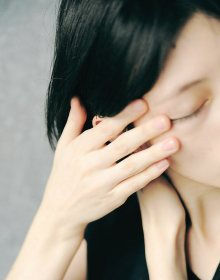 Woman with a stress tension headache