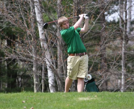Guy golfing in wooded area of golf course