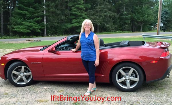 Ellen Burgan by her Camaro that brings joy