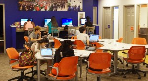 student working in a collaborative study environment at the Illini Union