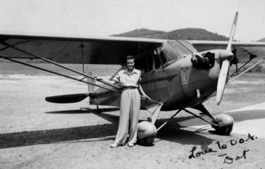 Dorothy Layne McIntyre next to her single-engine Piper Cub at West Virginia State College in 1940. She was a member of the Tuskegee airman. the slug is L07air.  07Lair