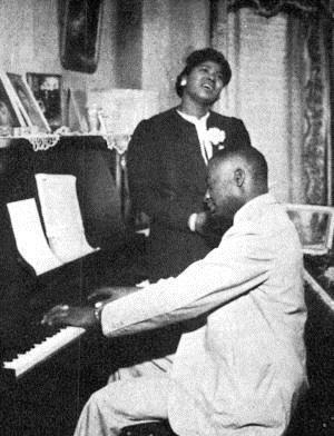 """""""Thomas Andrew Dorsey: Georgia native Thomas Andrew Dorsey began his musical career as blues pianist """"Georgia Tom,"""" even touring with Ma Rainey. Composing and arranging several successful blues hits, Dorsey's secular music career flourished. When he lost his beloved wife Nettie in childbirth and their infant son also died, his only solace was his faith. Out of that grief, he wrote """"Take My Hand, Precious Lord,"""" which his early protégé Mahalia Jackson sang at the funeral of Dr. Martin Luther King, Jr."""""""