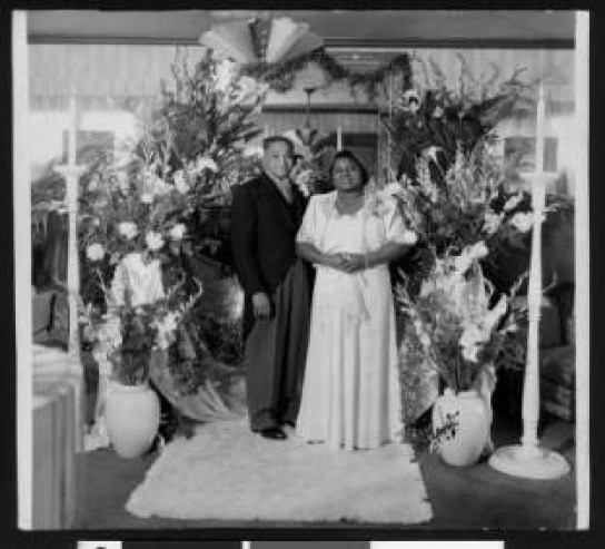 Photograph of actress Hattie McDaniel and her husband, Lloyd Crawford, on the couple's wedding day.