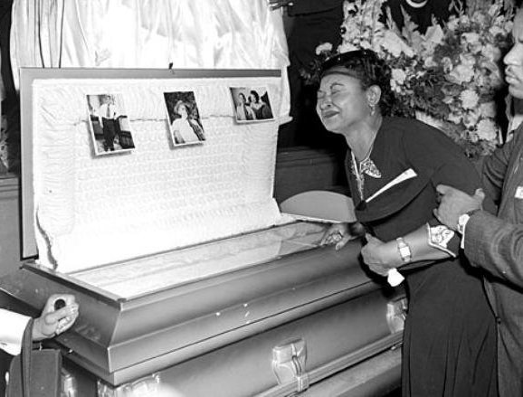 Emment Till's mother (Mamie Till) by his open casket
