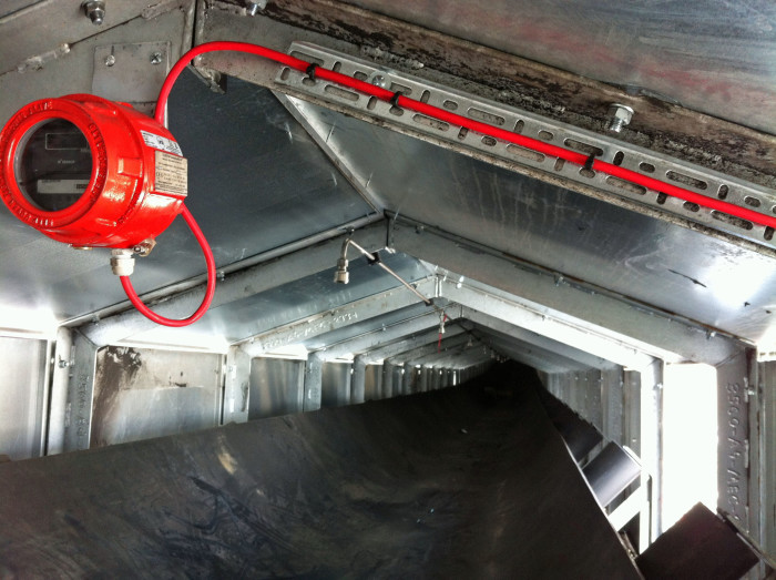 Talentum flame detector within the enclosed conveyor