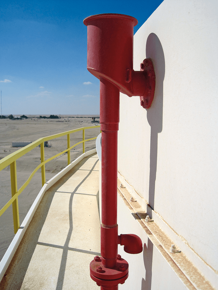 Foam chamber on tank. Note the wind girder with appropriate handrail. If the foam chamber was not present or did not function properly, the wind girder could be used to advance foam hoselines for seal fire extinguishment.