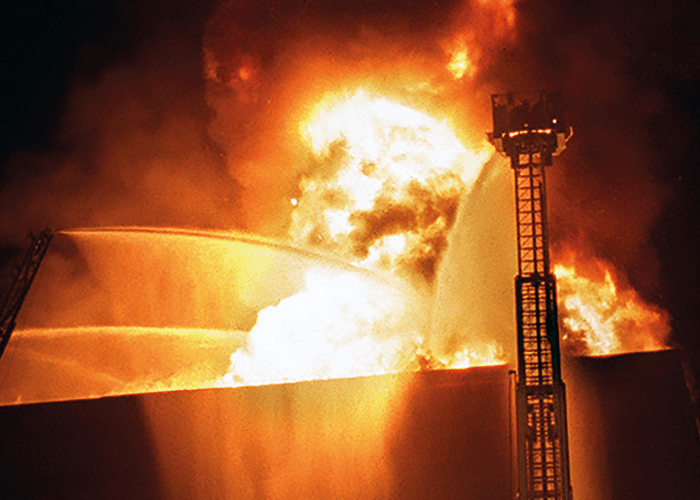 A photograph of the 1999 Worcester Cold Storage Warehouse Fire in Massachusetts which resulted in the deaths of six Worcester firefighters.