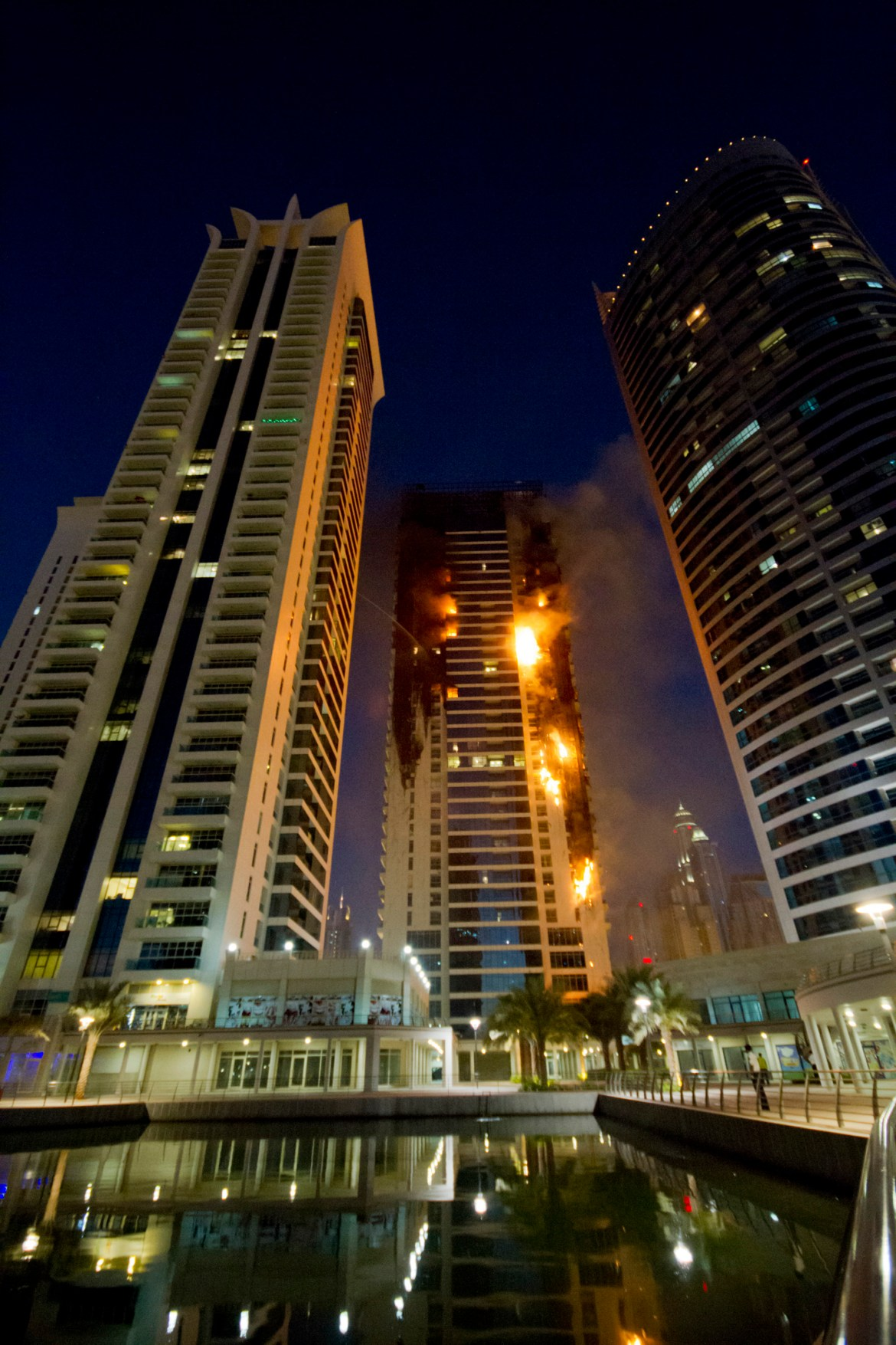 Flames engulf a portion of Tamweel residential tower at Jumeirah Lakes Towers, in Dubai, United Arab Emirates, Sunday, Nov. 18, 2012. Civil defense officials did not give immediate details on possible casualties or the cause of the predawn fire. (AP Photo/Kaveh Kashani)
