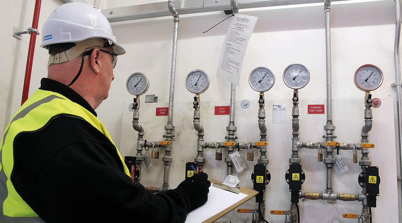 Checking and recording the water pressures on the fire pumps in the pump house serving the distribution centre.