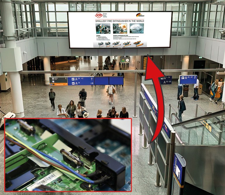 E-Bulb protected LED advertising screen at Frankfurt International Airport for enhanced fire-safety in public spaces.