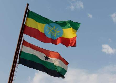 The flag of Ethiopia and, below it, the flag of Gambella flying at Saudi Star's farm
